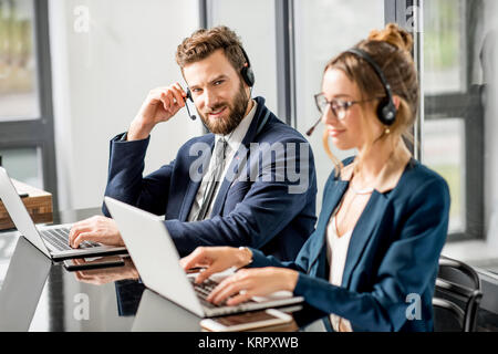 Business conference with headset - Stock Photo