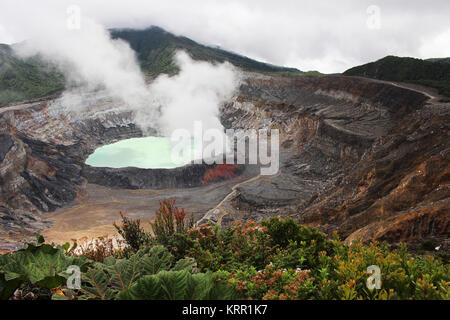 A hot sulfuric acid lake sits in the crater of Costa Rica's Poas Volcano. - Stock Photo