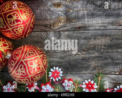 Christmas wooden background with toys for Christmas tree decoration - Stock Photo