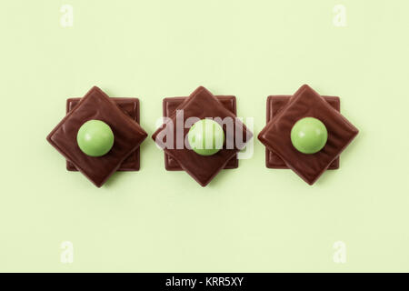 Mint Chocolates arranged in a line - Stock Photo