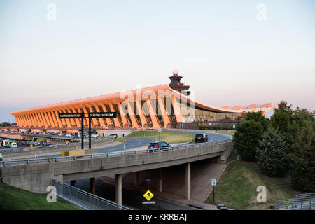 DULLES, Virginia - The late afternoon sunlight catches the original building, shaped like a wing, of Dulles International - Stock Photo