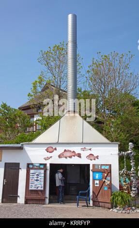 Fish smoke house at the beach of Vitt, Cape Arkona, North cape, Ruegen island, Baltic Sea, Germany - Stock Photo