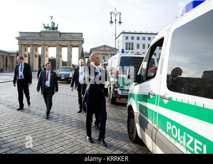 U.S. President Barack Obama greets local German police as he walks back to his hotel from the U.S. Embassy November - Stock Photo