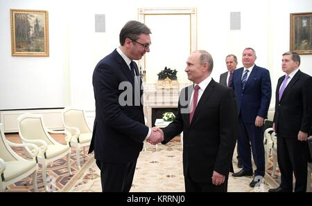 Russian President Vladimir Putin shakes hands with Serbian President Aleksandar Vucic, left, before their meeting - Stock Photo