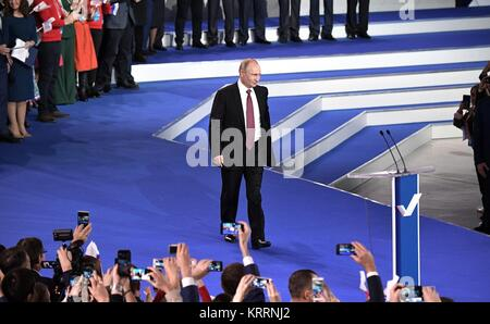 Russian President Vladimir Putin walks on to stage to address the All-Russia People's Front movement kicking off - Stock Photo