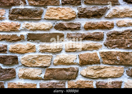 Part of the wall lined with a ginger stone for use as a background. - Stock Photo