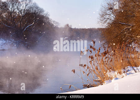 Sun and snowflakes. Sunny winter morning on a river - Stock Photo