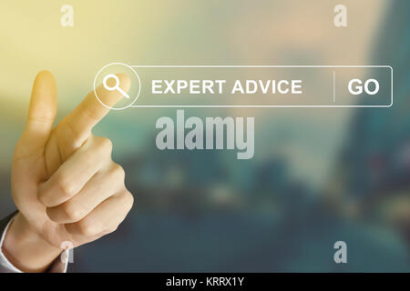 business hand clicking expert advice button on search toolbar - Stock Photo