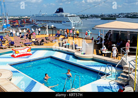 Rear pool deck of Holland America Line's Zuiderdam cruise ship with Norwegian Sun in background at port of Cartagena, - Stock Photo