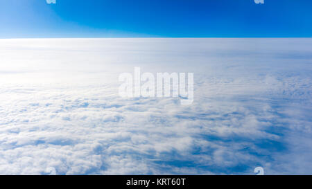 clouds from airplane window. height of 10 000 km.  Clouds - Stock Photo