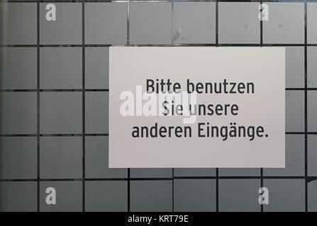 sign on a doorway that says  - Stock Photo