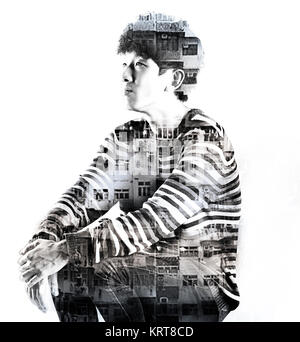 double exposure asian man and city buildings - Stock Photo
