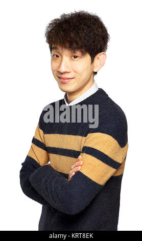 happy asian man with arms folded - Stock Photo