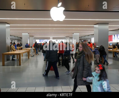Hordes of shoppers in the Apple store the Queens Center Mall in the borough of Queens in New York on Sunday, December - Stock Photo