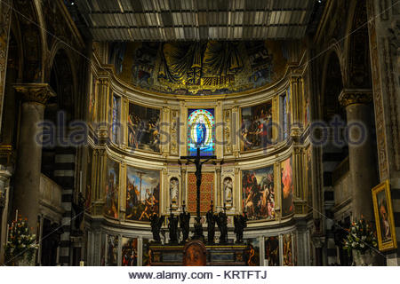 The interior altar featuring renaissance religious artwork of the Pisa Duomo Cathedral or Cattedrale Metropolitana - Stock Photo