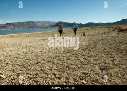 Women walk on beach at Lake Mead National Recreation Area Nevada, USA. - Stock Photo