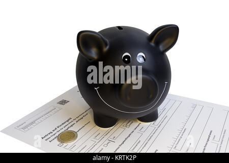 black piggy bank standing on child support request - Stock Photo