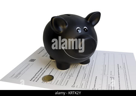 black piggy bank standing on child support application with two euro coin - Stock Photo