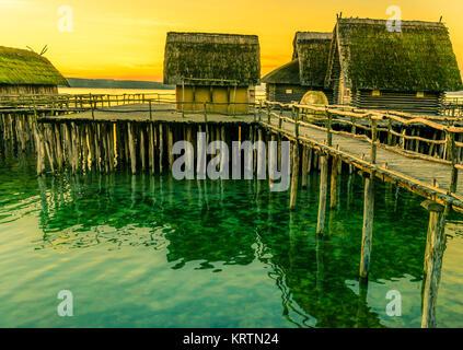 Fishing huts suspended on pillars - Stock Photo