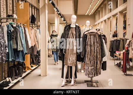 Milan, Italy - November 11, 2016: Luxury clothing shop in Milan fashion district, Italy. - Stock Photo
