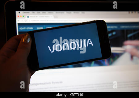 The Vonovia logo on a phone and website on a computer - Stock Photo