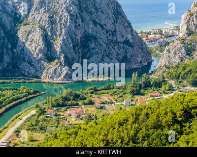 Estuary of the river Cetina. The dalmatian city Omis is visible through the ravine. - Stock Photo