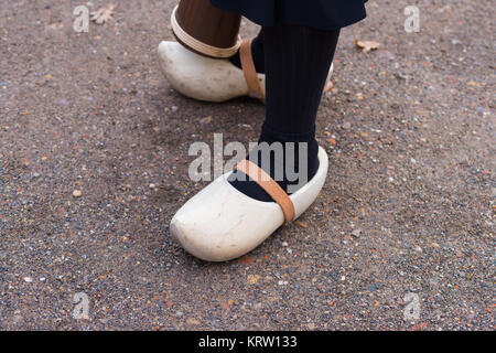 woman wearing clogs - Stock Photo