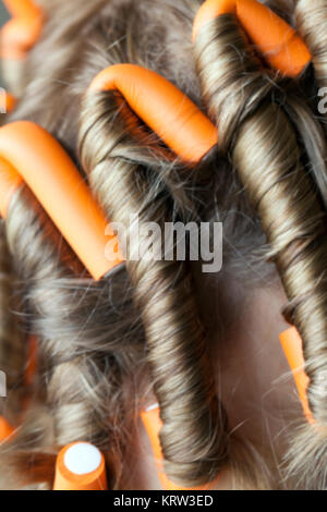 curlers in her hair - Stock Photo