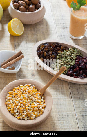 Table with dry fruits and various seeds - Stock Photo