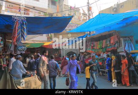 People visit Hazrat Nizamuddin complex Islamic area New Delhi India - Stock Photo