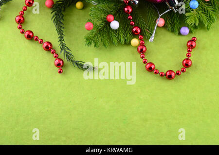 Christmas Decoration: Christmas ornaments with branch of Christmas tree - Stock Photo
