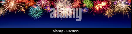 colorful firework display in panoramic format,with text space on blue - Stock Photo