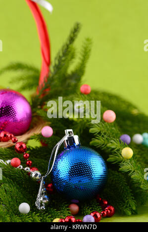 Christmas Decoration: Christmas ball and ornaments with the branch of Christmas tree - Stock Photo
