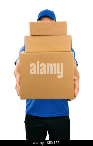delivery man holding pile of cardboard boxes in front - Stock Photo