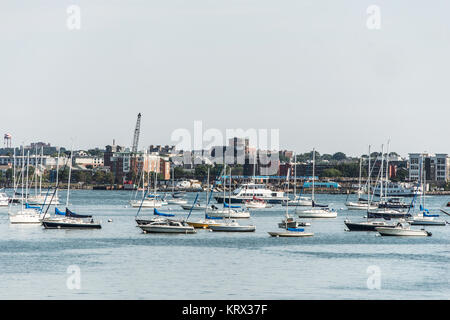 Sailing boats anchored on the Charles River in front of the old part of Boston town in Massachusetts USA - Stock Photo