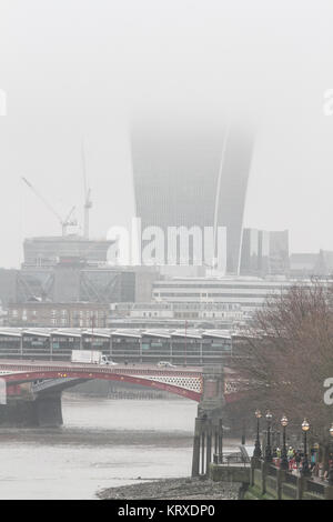 London UK. 21st December  2017. The skyline of the city of London financial district and buildings are shrouded - Stock Photo