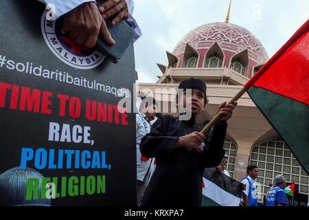 KUALA LUMPUR, MALAYSIA - DECEMBER 22: Children hold a Palestinian flag during Solidarity Save Baitulmaqdis (Jerusalem) - Stock Photo