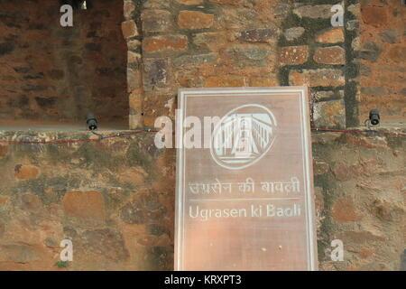 Ugrasen Ki Baoli signage in New Delhi India. Ugrasen Ki Baoli is a historical step well protected by Archaeological - Stock Photo