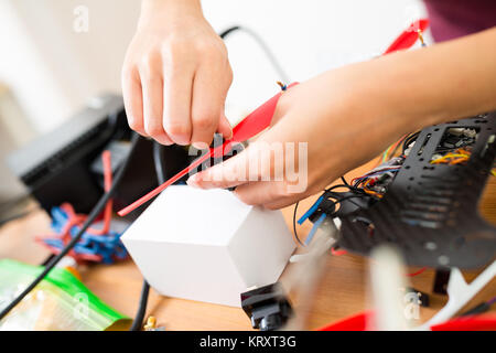 Woman install with the drone - Stock Photo