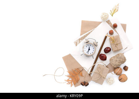 Autumn background with pencil, envelopes and an alarm clock. Top view. Space for your text. - Stock Photo