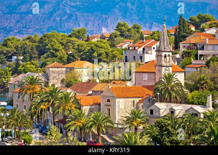 Splitska village stone landmarks in palm trees - Stock Photo