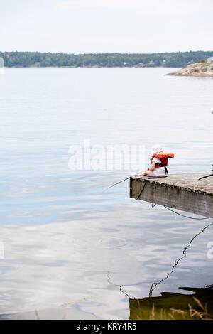 Young girl fishing - Stock Photo