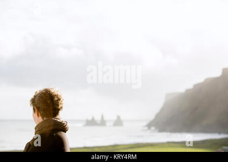A woman looking out to sea - Stock Photo