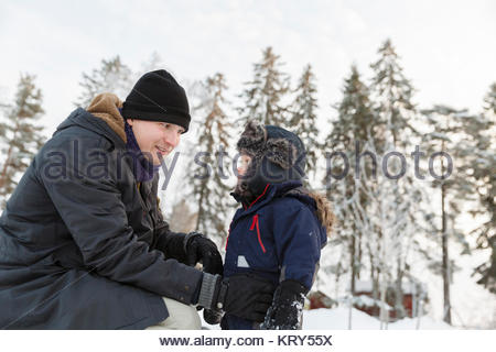 Father and son wearing hats during winter - Stock Photo