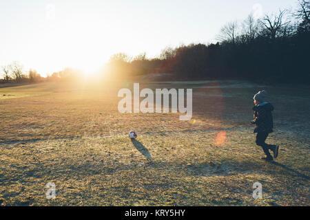 Boy playing soccer in Blekinge, Sweden - Stock Photo