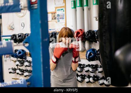 Senior woman at boxing training - Stock Photo