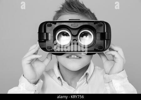 Kid looking at camera through VR glasses Stock Photo