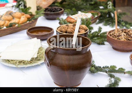 Christmas food on the table decorating with Christmas tree - Stock Photo