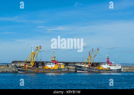 Two Trawlers berthed in Newlyn Harbour Penzance Cornwall - Stock Photo