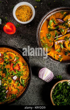 Indian food recipes, Masala Omelette with and Indian Omelet Masala Egg Curry, with fresh vegetables - tomato, hot - Stock Photo